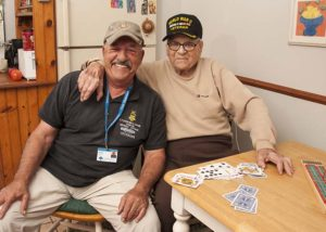 Care Dimensions Veteran-to-Veteran volunteer with hospice patient after a game of cribbage